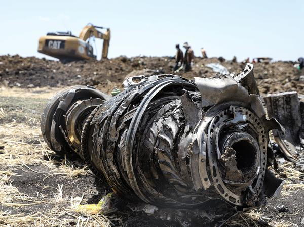 Debris from a Ethiopian Airlines Boeing 737 Max 8 jet sits in a field near Bishoftu, where the plane crashed after taking off from Addis Ababa Sunda